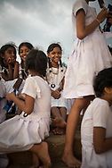 A group of fourth and fifth grade girls from the city of Kandy enjoy a school field trip, which includes eating ice cream at sunset in Galle Face Green in Colombo, Sri Lanka. (March 30, 2017)