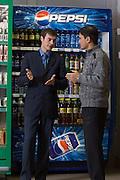 Moscow, Russia, 08/11/2007..Store manager Dzhamzhed Khairolayev and Pepsi New Business Customer Rep Ivan Voyevoda in one of the Dvenadtsat Mesyatsev [Twelve Months] supermarket chain.