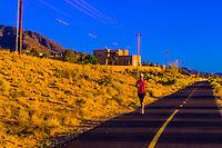Woman running on a path along Tramway Boulevard, Albuquerque, New Mexico USA