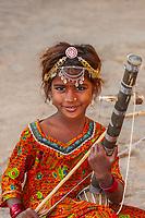 Girl playing musical instrument, Jaisalmer Fort, Jaisalmer, Rajasthan, India