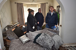 Welsh First Minister Mark Drakeford (centre) and Member of the Welsh Assembly for Pontypridd, Mick Antoniw (right), with resident Caroline Jones inspecting flood damage at her house in Oxford Street, Nantgarw, in south Wales, where residents are returning to their homes to survey and repair the damage in the aftermath of Storm Dennis.