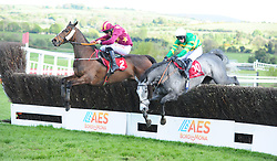 Heron Heights and Davy Russell (left) take advantage of the last fence error of Onefortheroadtom (right) to win the Palmerstown House Pat Taaffe Handicap Chase during day five of the Punchestown Festival at Punchestown Racecourse, County Kildare, Ireland.