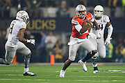 Cardale Jones #12 of the Ohio State Buckeyes scrambles against the Oregon Ducks during the College Football Playoff National Championship Game at AT&T Stadium on January 12, 2015 in Arlington, Texas.  (Cooper Neill for The New York Times)