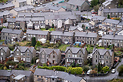 Streets and houses in the industrial revolution-era town of Blaenau Ffestiniog, on 3rd October 2021, in Blaenau Ffestiniog, Gwynedd, Wales. The derelict slate mines around Blaenau Ffestiniog in north Wales were awarded UNESCO World Heritage status in 2021. The industry's heyday was the 1890s when the Welsh slate industry employed approximately 17,000 workers, producing almost 500,000 tonnes of slate a year, around a third of all roofing slate used in the world in the late 19th century. Only 10% of slate was ever of good enough quality and the surrounding mountains now have slate waste and the ruined remains of machinery, workshops and shelters have changed the landscape for square miles.
