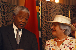 March 10, 1998 - Cape Town, South Africa - NELSON MANDELA, the South African President talks to his guest, German President's wife, CHRISTIANE HERZOG, after the signing cermony, at the Presidential offices in Cape Town. German President and wife are on a four day official visit to South Africa. (Credit Image: © Sasa Kralj/JiwaFoto/ZUMAPRESS.com)
