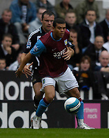 Photo: Jed Wee/Sportsbeat Images.<br /> Newcastle United v Aston Villa. The FA Barclays Premiership. 18/08/2007.<br /> <br /> Aston Villa's Wilfred Bouma (R) holds off Newcastle's Mark Viduka.