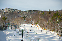 Skiers and riders on the Smith Trail at Gunstock Mountain Resort on Friday for opening day.  (Karen Bobotas Photo/for The Laconia Daily Sun)