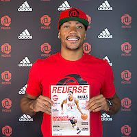 12 July 2013: Chicago Bulls superstar Derrick Rose holds an issue of french basketball magazine Reverse during Adidas' D Rose tour,  in Paris, France.