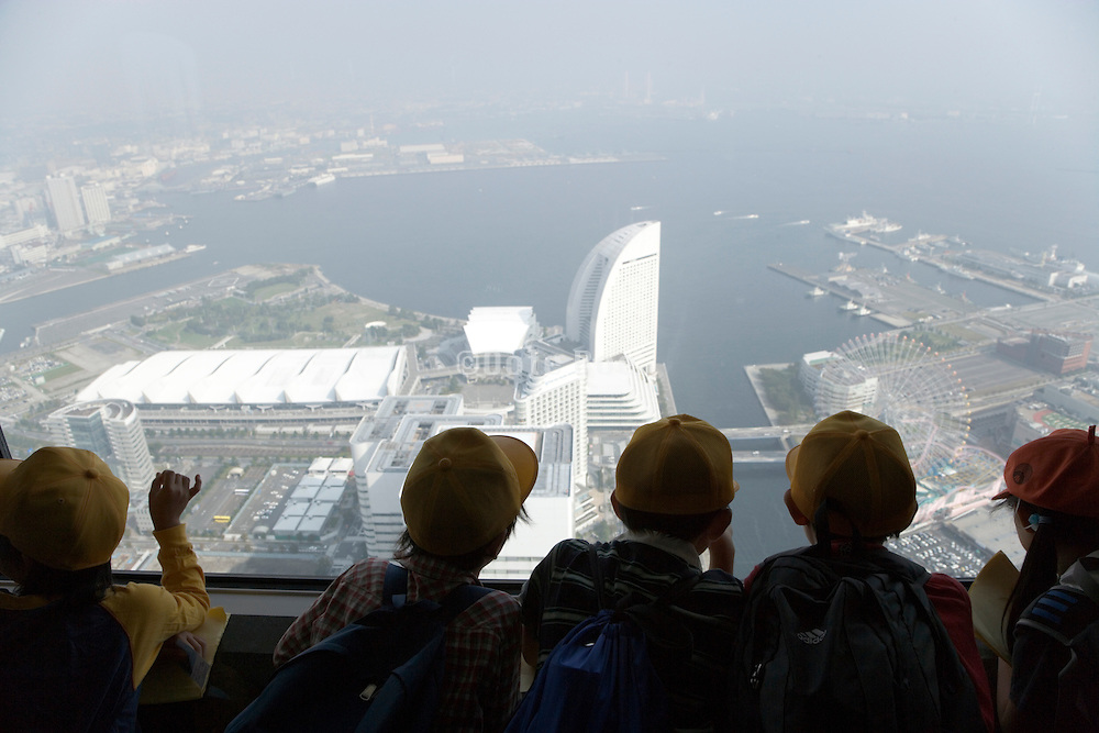 Japan children looking out over the Intercontinental Hotel from the Landmark Tower Yokohama