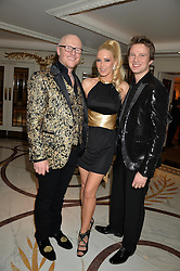 Left to right, JOHN CAUDWELL, EMMA NOBLE and CONRAD BAKER at a birthday dinner for Claire Caudwell for family & friends held at The Dorchester, Park Lane, London on 24th January 2014.