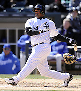 CHICAGO - APRIL 03:  Dayan Viciedo #24 the Chicago White Sox hits a home run the fourth inning against the Kansas City Royals on April 3, 2013 at U.S. Cellular Field in Chicago, Illinois.  The White Sox defeated the Royals 5-2.  Ramirez was charged with an error on the play.(Photo by Ron Vesely)   Subject: Dayan Viciedo