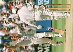 South African paceman Shaun Pollock (right) rushes forward to celebrate capturing the wicket of England's Alec Stewart (center) during play this morning (Thursday) at Newland's Cricket Ground in Cpetown, venue of the fifth and final Test. (player left is Gary Kirsten)