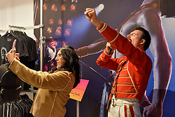"© Licensed to London News Pictures. 18/10/2018. LONDON, UK.  A visitor takes a selfie with a waxwork of Freddie Mercury at the Queen pop-up shop which has opened in Carnaby Street.  Coinciding with the release next week of the movie ""Bohemian Rhapsody"", the shop offers Queen music fans memorabilia, a display of stage costumes as well as archived Queen performance footage.  Photo credit: Stephen Chung/LNP"