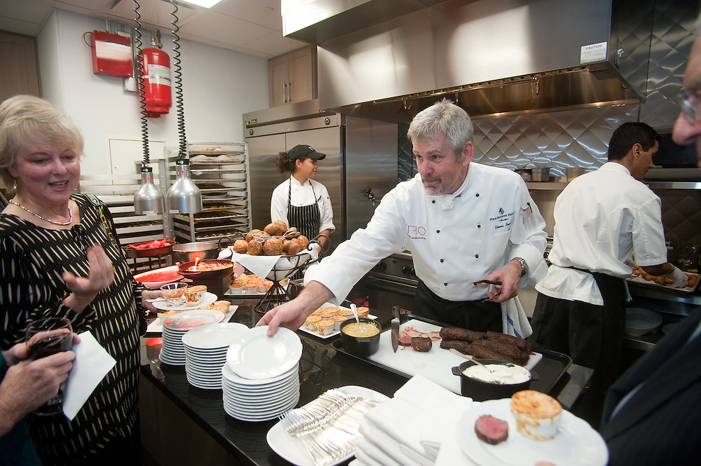 The Four Seasons Residences Austin hosted a party Friday night for current, future and prospective residents. Chef Elmar Prambs serves food to the guests.