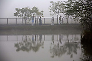 Residents on their early morning walk around the pond at dawn at the Tamaraikulum Elders's Village