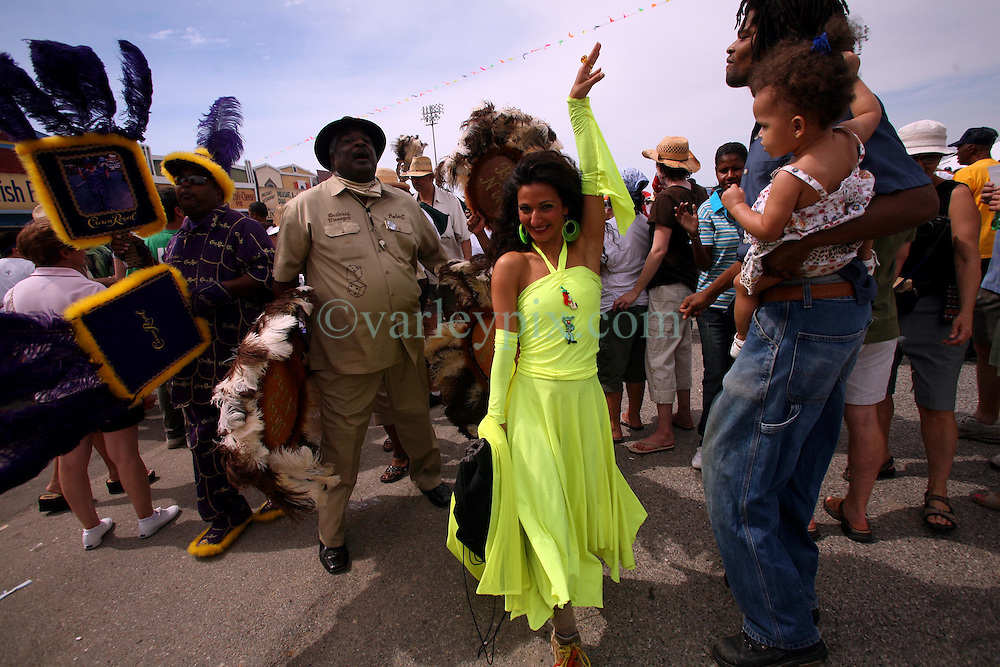 April 27 2007. New Orleans, Louisiana. The New Orleans Jazz and Heritage Festival. Members of the Creole Wild West Mardi Gras Indians dressed in all their finery perform on the Jazz and Heritage Stage. <br /> Photo credit; Charlie Varleyvarleypix.com