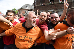 May 27, 2018 - Mons, BELGIUM - Men cheer during the Ducasse - Doudou folkloric festival in Mons, Sunday 27 May 2018. The Doudou feast compromises two parts, a procession with the shrine of Waltrude and the fight between Saint George and the dragon. The Doudou was recognized in 2005 by UNESCO as one of the masterpieces of the Oral and Intangible Heritage of Humanity. ..BELGA PHOTO LAURIE DIEFFEMBACQ (Credit Image: © Laurie Dieffembacq/Belga via ZUMA Press)