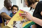 A young family get to spend some extended time together reading stories during a family visit in HMP Brixton, South London on the 26th of July 2016, London United Kingdom. The Prisoner Advice & Care Trust (PACT) organise special family days that help the men inside the prison connect with and support their partners and children on the outside. (photo by Andy Aitchison)