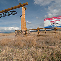 """A real estate sign advertises """"ranchettes"""" for sale in near Three Forks, Montana."""