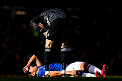 David De Gea of Manchester United leans over an injured Richarlison of Everton - Mandatory by-line: Robbie Stephenson/JMP - 01/03/2020 - FOOTBALL - Goodison Park - Liverpool, England - Everton v Manchester United - Premier League