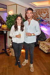 Racing drivers JAMIE CHADWICK and STRUAN MOORE at a party hosted by Nancy Dell'Olio to celebrate the launch of Limonbello held at The Club at The Ivy, 9 West Street, London on 20th July 2016.