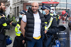 © Licensed to London News Pictures. 19/12/2020. London, UK. Gym owner Andreas Michl is arrested by police officers for taking  part in an Anti Covid-19 lockdown demonstration in Central London. The group against the current tier regulations and against vaccination for the Covid-19 disease. Photo credit: Ray Tang/LNP