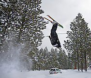 """Trevor Berry, a Tollgate resident, gets airborne over a snow berm along Lasso Dr.  He was towed along the road before launching his jump.  He commented saying, """"If I can't get to the mountain, I'll bring the mountain to me."""""""