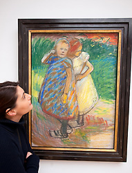 Woman looking at painting Zwei Madchen or Two girls by Franz Nolken at Kunsthalle art gallery in Hamburg German