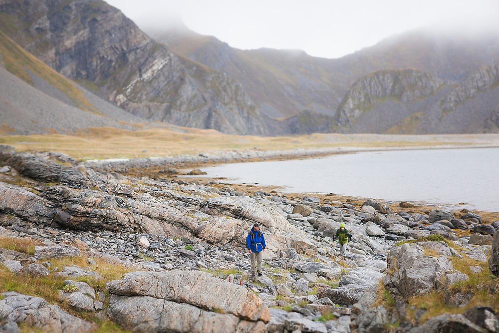 Parmenter (left) and Liana Welty explore the rocky coast of Vaeroy Island, Lofoten Islands, Norway.