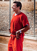 """04 FEBRUARY 2010 - CAMP VERDE, AZ: James Arthur Ray walks back to the Yavapai County Jail from the county courthouse after his initial appearance Thursday. Ray had his initial appearance in Yavapai County Court in Camp Verde Thursday morning. His bail was set at $5 Million Dollars (US). Ray did not post bail and remains in jail. Ray was arrested in Prescott, AZ, on Feb 3 and charged with three counts of manslaughter after three people died during a sweat lodge ceremony he was holding in Sedona, AZ, in October 2009. The ceremony was a part of a """"Spiritual Warrior"""" workshop Ray was leading. He charged participants $8,000 each. PHOTO BY JACK KURTZ    NO SALES"""