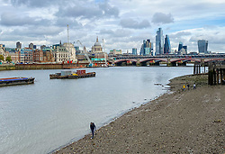 © Licensed to London News Pictures. 23/10/2020. London, UK. Quiet Thames riverbank and a view of City of London and Millennium Bridge at the start of the half term holiday. Normally, Thames riverbank around Millennium Bridge would be busy with tourists. However, due toLondon being in COVID-19 tier two restrictions, and local and regional areas in tier three, there are less tourists as the government has imposed tougher measures to manage increasing cases. Photo credit: Dinendra Haria/LNP