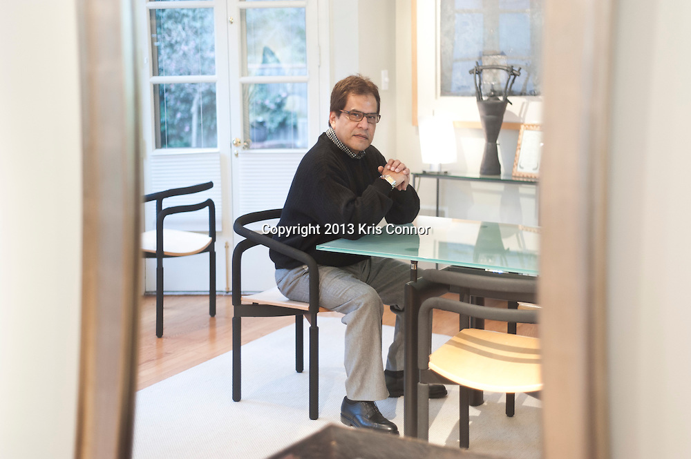 Mario Castillo of The Aegis Group poses for a portrait at his home in northwest Washington D.C. on January 11, 2013. Photo by Kris