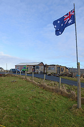 EXCLUSIVE: An Australian man has created his own Outback outpost 11,000 miles from home on the Shetland Islands – and he even has WALLABIES. Tasmanian Dave Kok, 42, has built his own Aussie oasis on the Scottish archipelago after deciding to settle there when he was travelling Europe. Now Dave lives with his Shetland native wife Louise, 38, and two daughters Caitlin, 11, and Ruby, aged four. Social care worker Dave came to the islands in the late 90s and since 2016 has been building his own watering hole choc-full of Australiana on the island of Burra. Dave's place 'The Outpost' is a renovated wooden porta cabin filled with Tasmanian beers, Tim Tams, books on bush craft and Aussie Rules sporting memorabilia. Locals use the Outpost as their local bar and meeting place, as the nearest pub or café is three bridges and three islands away. And visitors can now enjoy the Outpost's wallabies Ned and Kelly who David brought to the island this winter. Based on the Shetland Islands latitude the marsupials could be the most northerly of their species anywhere on the planet. Dave said visiting Australians are often surprised to find the antipodean paradise in such a remote location. 16 Feb 2018 Pictured: Pic from Dave Donaldson/ Magnus News Agency. Pic shows the Aussie-themed Outpost in the Shetland Islands. An Australian man has created his own Outback outpost 11,000 miles from home on the Shetland Islands – and he even has WALLABIES. Tasmanian David Kok, 42, has built his own Aussie oasis on the Scottish archipelago after deciding to settle there when he was travelling Europe. Now David lives with his Shetland native wife Louise and two daughters Caitlin, 11, and Ruby, aged four. Social care worker David came to the islands in the late 90s and has built his own watering hole choc-full of Australiana on the island of Burra. David's place 'The Outpost' is a renovated wooden porta cabin filled with Tasmanian beers, Tim Tams, books on bush craft and Aussie Rule
