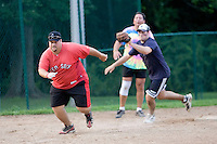 WETHERSFIELD-081811JT.Republicans' Mike Bigda is chased down by Democrats' Matt LeBeau during Thursday's charity softball game at Mill Woods Park in Wethersfield, organized by the state's Young Democrats and Young Republicans..Photo by Josalee Thrift