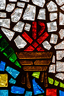 Stained glass depicting the manger and Chi Rho, on Tuesday, Aug. 24, 2021, at Grace Lutheran Church, Summerville, S.C. LCMS Communications/Erik M. Lunsford