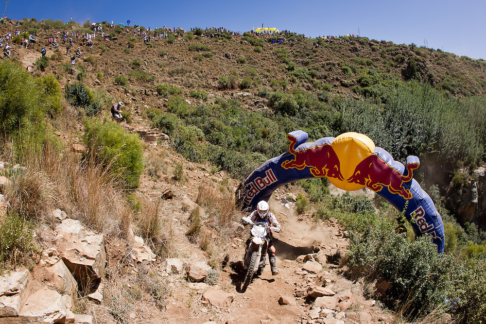 The Red Bull Arch two thirds of the way up Free Fall climb during the 44th running of the Roof of Africa enduro held in Lesotho.