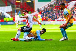 Semi Ajayi of Rotherham United slides in to tackle John Fleck of Sheffield United - Mandatory by-line: Ryan Crockett/JMP - 09/03/2019 - FOOTBALL - Bramall Lane - Sheffield, England - Sheffield United v Rotherham United - Sky Bet Championship