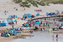 © Licensed to London News Pictures. 02/08/2018. Perranporth, UK. Large numbers of people are seen on Perranporth beach in Cornwall during hot weather. Photo credit : Tom Nicholson/LNP