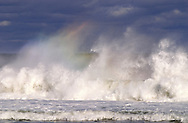 A moving wave sometimes will create a fleeting rainbow