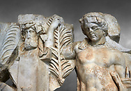 Detail of a Roman Sebasteion relief  sculpture of Agon Aphrodisias Museum, Aphrodisias, Turkey. <br /> <br /> The scene is an allegory of the athletic contest (or agon). The pillar was a beareded head of Hermes the god of the Gymnasium. Nearby is a palm of victory and a prize table with victory ribbon on it. Two winged baby Eros figures are struggling over a palm branch ( mostly broken): they act out the idea of contest, which is personified in the youthful figure behind. He hold another palm of victory: he is Agon himself. .<br /> <br /> If you prefer to buy from our ALAMY STOCK LIBRARY page at https://www.alamy.com/portfolio/paul-williams-funkystock/greco-roman-sculptures.html . Type -    Aphrodisias     - into LOWER SEARCH WITHIN GALLERY box - Refine search by adding a subject, place, background colour, museum etc.<br /> <br /> Visit our ROMAN WORLD PHOTO COLLECTIONS for more photos to download or buy as wall art prints https://funkystock.photoshelter.com/gallery-collection/The-Romans-Art-Artefacts-Antiquities-Historic-Sites-Pictures-Images/C0000r2uLJJo9_s0