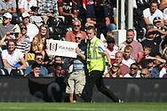 A fan invades the field of play holding a message as he is taken away by a steward.. EFL Skybet football league championship match, Fulham  v Norwich city at Craven Cottage in London on Saturday 5th August 2017.<br /> pic by Steffan Bowen, Andrew Orchard sports photography.