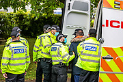 """Leicester, United Kingdom, May 24, 2021: Two local residents who were trying to provide food to the """"Palestine Action"""" activists were arrested (in picture) by police in Leicester on Monday, May 24, 2021. Another local resident who was filming from his own private car got also arrested. (Photo by Vudi Xhymshiti)<br /> <br /> Police protestor removal crew arrived at the building of the Israeli-owned Elbit-Thale subsidiary UAV Tactical Systems after it has been occupied for six consecutive days by the """"Palestine Action"""" activists' group. Both remaining activists were removed from the rooftop and arrested, meanwhile local communities' have organised a barricade and appear to be determined to not let the police leave the area with activists. """"Shut Elbit Down"""", """"Free! Free! Palestine"""" are among the slogans local residents are shouting."""