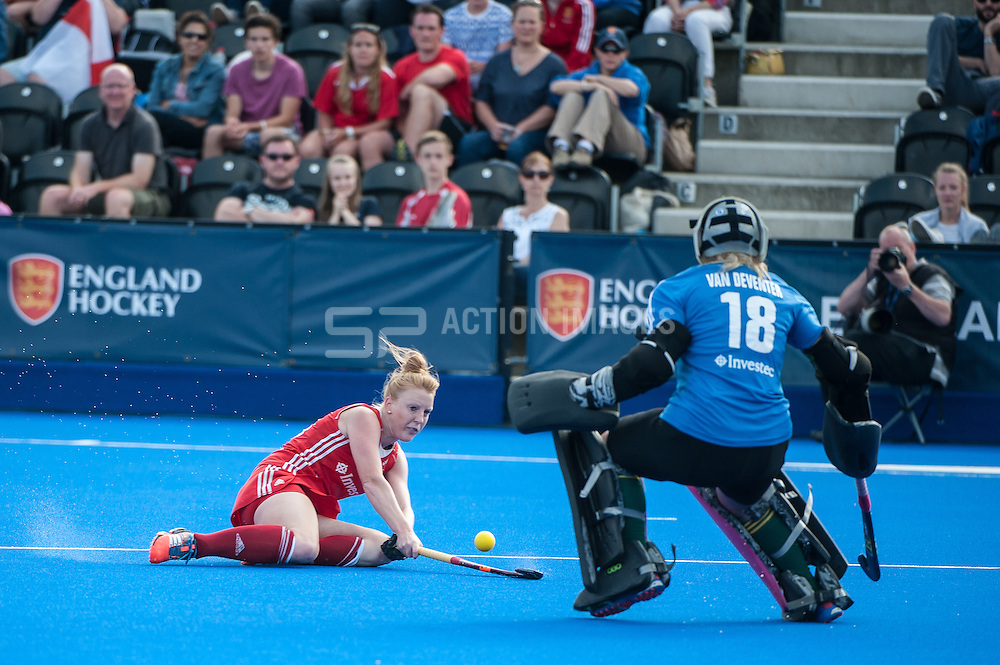 England's Nicola White crosses the ball past Anelle Van Deventer of South Africa during the Final of the Investec London Cup. Lee Valley Hockey & Tennis Centre, London, UK on 13 July 2014. Photo: Simon Parker