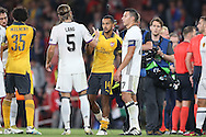 Theo Walcott of Arsenal © shakes hands with Michael Lang of FC Basel after the final whistle. UEFA Champions league group A match, Arsenal v FC Basel at the Emirates Stadium in London on Wednesday 28th September 2016.<br /> pic by John Patrick Fletcher, Andrew Orchard sports photography.
