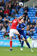 Joseph Worrall of Nottingham Forest (l) jumps for a header with Anthony Pilkington of Cardiff city. EFL Skybet championship match, Cardiff city v Nottingham Forest at the Cardiff City Stadium in Cardiff, South Wales on Easter Monday 17th April 2017.<br /> pic by Andrew Orchard, Andrew Orchard sports photography.