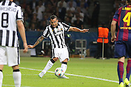 Carlos Tévez of Juventus shoots  at goal during the Champions League Final between Juventus FC and FC Barcelona at the Olympiastadion, Berlin, Germany on 6 June 2015. Photo by Phil Duncan.