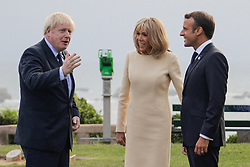 French President Emmanuel Macron and his wife Brigitte Macron welcome Britain Prime Minister Boris Johnson at the Biarritz lighthouse, southwestern France, ahead of a working dinner on August 24, 2019, on the first day of the annual G7 Summit. Photo by Thibaud Moritz/ABACAPRESS.COM