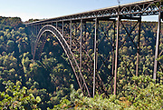 """The New River Gorge Bridge, a part of US Highway 19, is a steel-arch bridge, in Fayetteville, West Virginia, USA. With a length of 3030 feet (924 m), it was for many years the longest in the world of that type. Its arch extends 1700 feet (518 m). BASE jumping is allowed on """"Bridge Day"""" held every October on the third Saturday, but Bungee jumping has been banned from Bridge Day since an accident in 1993. The New River Gorge National River is a unit of the United States National Park Service designed to protect and maintain the New River Gorge in southern West Virginia, USA. Established in 1978, the area stretches for 53 miles (85 km) from just downstream of Hinton to Hawks Nest State Park near Ansted."""