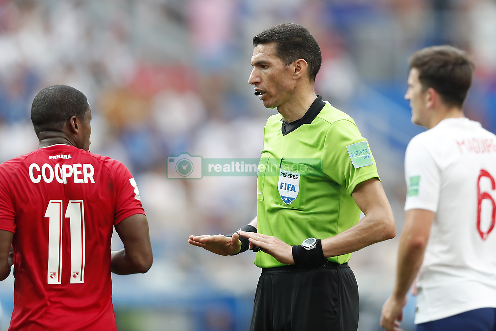 (L-R) Armando Cooper of Panama, referee Ghead Grisha, Harry Maguire of England during the 2018 FIFA World Cup Russia group G match between England and Panama at the Nizhny Novgorod stadium on June 24, 2018 in Nizhny Novgorod, Russia