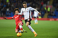 Rotherham's Tom Lawrence is tackled by Cardiff's Kim Bo-Kyung.  Skybet football league championship match, Cardiff city v Rotherham Utd at the Cardiff city stadium in Cardiff, South Wales on Saturday 6th December 2014<br /> pic by Andrew Orchard, Andrew Orchard sports photography.